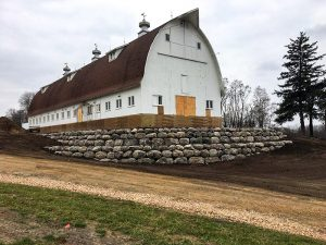 a barn with a new retaining wall