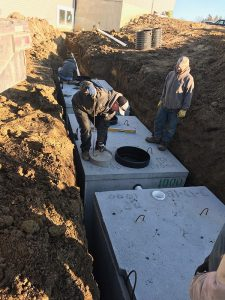 septic tanks being put into the ground